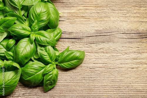 Fotografía Basil leaves on wooden background