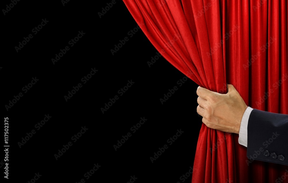 Fototapeta Hand open stage red curtain on black background
