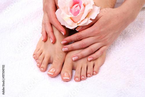 Photo sur Aluminium Pedicure pedicure on legs and beautiful manicure hands closeup