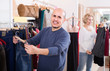 spouses buying pair of classic jeans in boutique
