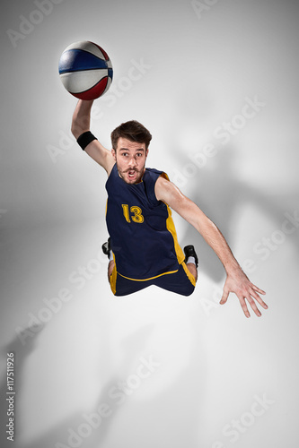 Full length portrait of a basketball player with ball - 117511926