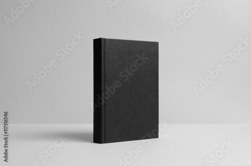 Fotografering  Black Hardcover Book Mock-Up - Wall Background