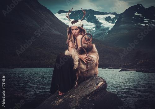 Nordic goddess in ritual garment near wild mountain lake in Innerdalen valley Poster Mural XXL