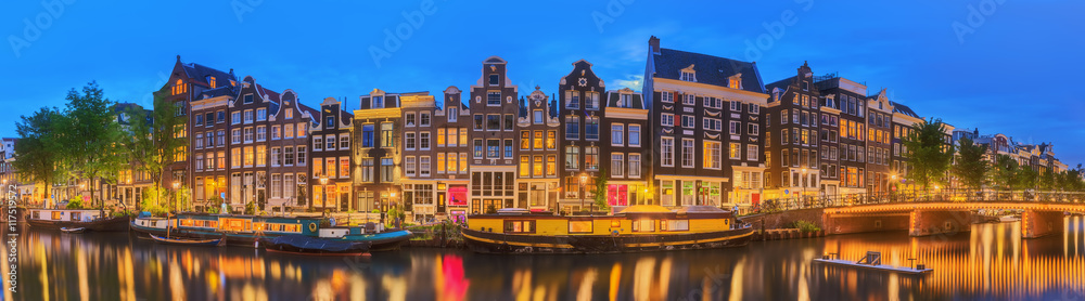 Fotografiet Amstel river, canals and night view of beautiful Amsterdam city