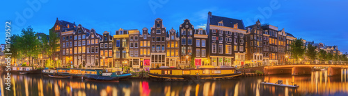 Amstel river, canals and night view of beautiful Amsterdam city Canvas Print