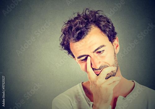 Valokuva  portrait of sad man looking down