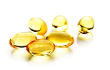 Fish Oil Pill On White Backgro...