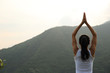 young fitness woman practice yoga at mountain peak