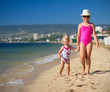 Two girls on sea coast