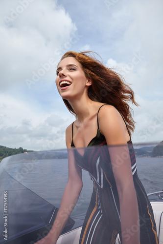Foto op Plexiglas Water Motor sporten Summer vacation - young woman driving a motor boat