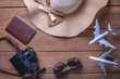 Travel accessories and costume on table with clothes ready to be