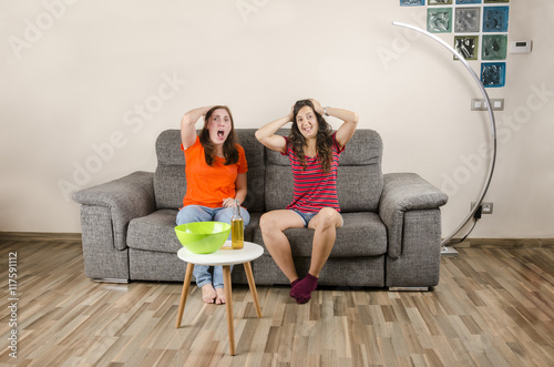 Fans women is sad in a living room watching TV - Buy this stock ... 3eb9dc789f