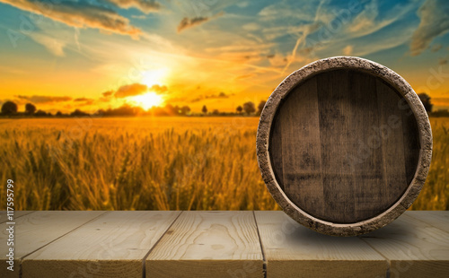 Fotografering background of barrel and worn old table of wood