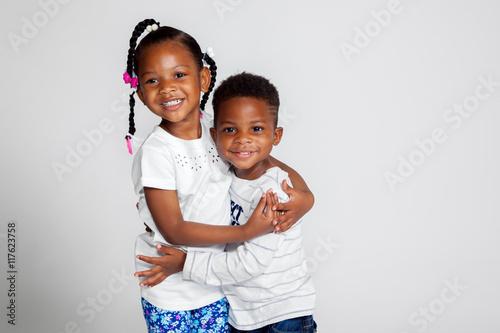 Fotografie, Obraz  Young African American Siblings Hugging