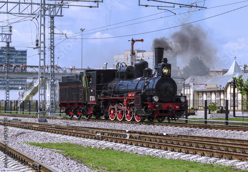 fototapeta na ścianę Demonstration of restored vintage locomotives at the celebration of the Day of railway troops of the Russian Federation in Moscow. Steam Locomotive Ov-324