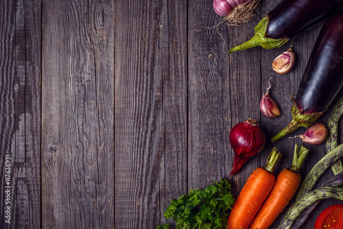 Foto op Plexiglas Fitness Fresh vegetables for cooking on dark wooden background with spac