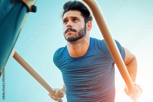 Muscular man working out outdoors Canvas Print
