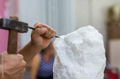 Fotografie, Obraz Man carving stone statue