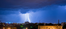 Night Thunderstorm Over The Buildings