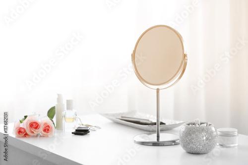 Fototapeta Round mirror on white dressing table
