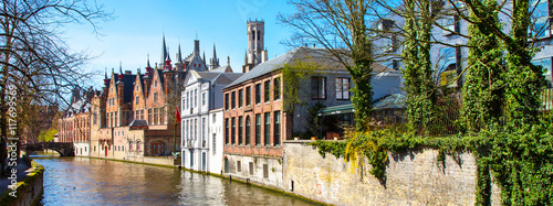 Panoramic cityscape with houses, bridge and canal in Bruges, Belgium