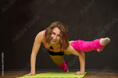 Spoed Foto op Canvas Gymnastiek young athletic girl trains in the gym