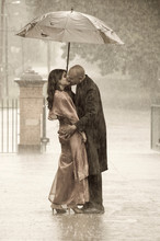 Indian Smartly Dressed Couple Holding An Umbrella In The Rain Ki
