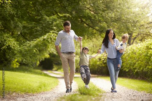 Fotografie, Obraz  Family Going For Walk In Summer Countryside