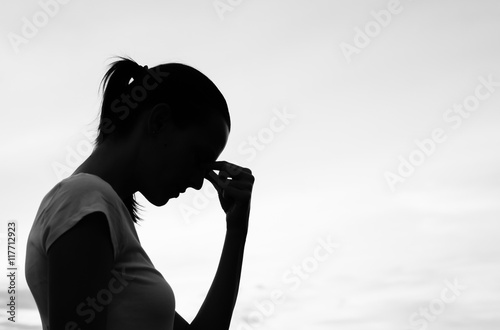 Silhouette of a tired and stressed woman. Canvas Print