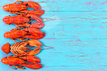 Colorful Red Lobster Border On Blue Wood