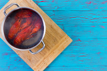 Two Freshly Boiled Whole Lobsters In A Pot