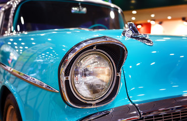 Fototapeta Samochody Color detail on the headlight of vintage car