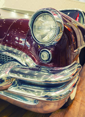 Fototapeta Samochody Color detail on the headlight of vintage american car.