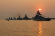 Silhouette Of Military Ships On Sunset