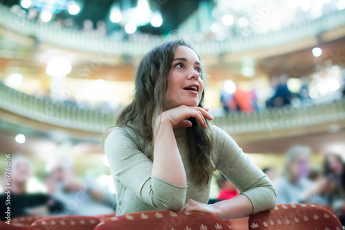 young woman looking theatre performance. Wallpaper Mural