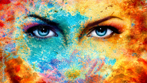 Fototapeta A pair of beautiful blue women eyes beaming, color rust effect,  obraz