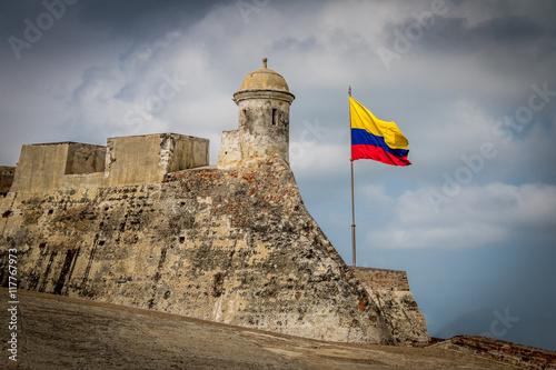 Photo Stands South America Country Castillo de San Felipe and colombian flag - Cartagena de Indias, Colombia