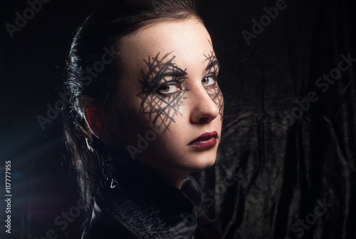Photo Young beautiful girl with make-up for Halloween,