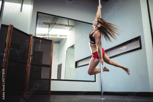 Poster Dance School Pole dancer practicing pole dance