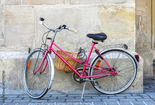 Pink bike in city center of Krakow, Poland. © agneskantaruk
