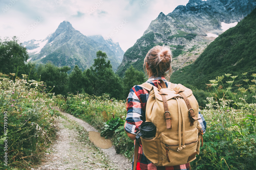 Fototapety, obrazy: Hiker walking to mountains