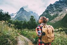 Hiker Walking To Mountains