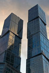 Obraz na Szkle Moskwa glass towers on a summer evening