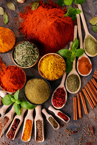 Variety of spices on kitchen table - 117829728