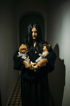 Mysterious Girl With Dolls.
