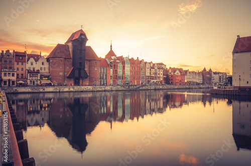 Foto auf Gartenposter Stadt am Wasser Gdansk old town with harbor and medieval crane in the evening