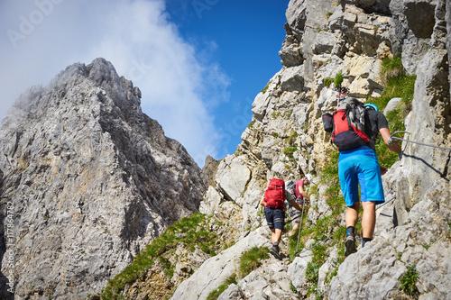 Montage in der Fensternische Bergsteigen mountaineering men / climbing in the alps of Austria at Wilder Kaiser