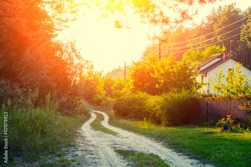 Foto op Canvas Rood paars Rural morning landscape with dirt road