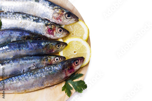 Photo  seafood, fish: sardines isolated on white