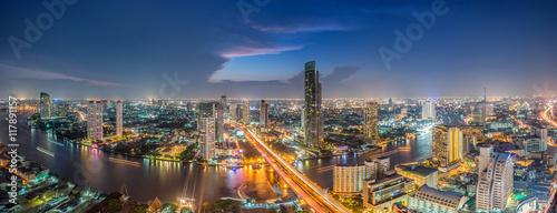 Spoed Foto op Canvas Bangkok Bangkok Transportation at Dusk with Modern Business Building alo